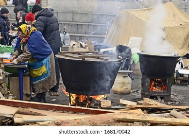 KIEV, UKRAINE -DECEMBER 18: EuroMaydan  on 18 December 2013 in Kiev. Zone of field kitchen with two big cauldrons under open sky on Square of Independence