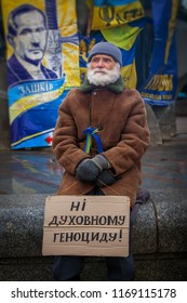 Kiev. Ukraine. December 19, 2013. Grandfather protesting at the barricades of the EuroMaidan.