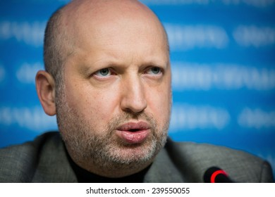 KIEV, UKRAINE  - DECEMBER 20, 2014: Secretary of the National Security and Defence Council of Ukraine Oleksandr Turchynov holds a breefing after ending of a meeting of NSDC