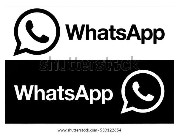 Kiev, Ukraine - December 20, 2016: Black WhatsApp  logo and icon printed on a white paper. WhatsApp - proprietary messenger for smartphones. Allows you to send text messages, images, video and audio.