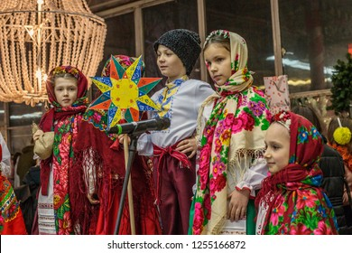 KIEV, UKRAINE - December 2018: Traditional Ukrainian Christmas songs called Kolyadki, Ukrainian kids dressed in traditional folk clothes singing Christmas songs, Ukraine