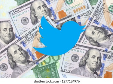 Kiev, Ukraine -  December 26,  2018: Twitter bird icon printed on paper and placed on money background. Twitter is an American online news and social networking service.