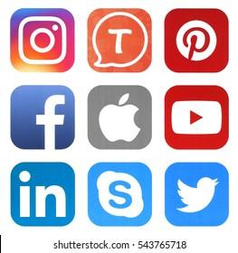 KIEV, UKRAINE - DECEMBER 27, 2016: Collection of popular social media logos printed on paper: Facebook, Twitter, Instagram, Tango, Skype, YouTube, Pinterest, LinkedIn, and Apple