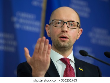 KIEV, UKRAINE - DECEMBER, 29, 2015: Prime-minister Arsenii Yatseniuk gestures during press-conference