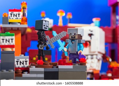 Kiev, Ukraine - December 29, 2019: Minifigure of Steve with diamond  sword fighting with Wither Skeleton. Characters of the game Minecraft.