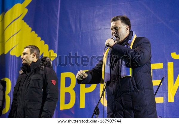 KIEV, UKRAINE - DECEMBER 5: Leader of the Ukrainian party Svoboda Oleh Tyahnybok speaks to protester during the rally of the opposition on Independence Square in Kiev on December 5, 2013.