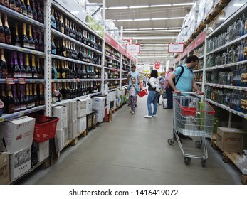 Kiev, Ukraine, Europe - May 2019: Showcase with bottles of alcoholic beverages in the Auchan supermarket. Alcohol trade in the market. Champagne.