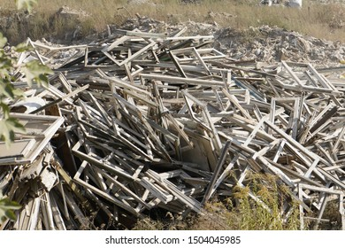 Kiev, Ukraine, Europe - September 2019: Landfill of construction waste. Ecology, environmental pollution. Garbage in the woods. Window frames in a landfill.