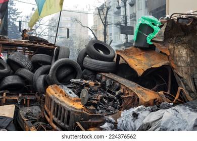 KIEV, UKRAINE - Feb 12, 2014: Mass anti-government protests in the center of Kiev. Barricades, ruin and chaos on Hrushevskoho St.