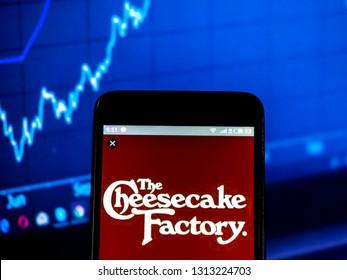 KIEV, UKRAINE - Feb 14, 2019: Cheesecake Factory, Inc. restaurant company  logo seen displayed on smart phone