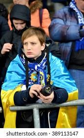 Kiev, UKRAINE - FEB 24: Fans at the stadium with attributes before the UEFA Champions League match between Dynamo Kiev vs Manchester City (England), 24 February 2016, Ukraine