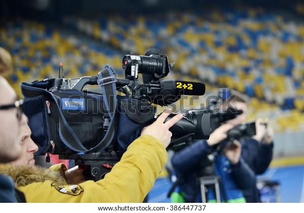 Kiev, UKRAINE - FEB 24: The operator with the camera on the football training before the UEFA Champions League match between Dynamo Kiev vs Manchester City (England), 24 February 2016, Ukraine