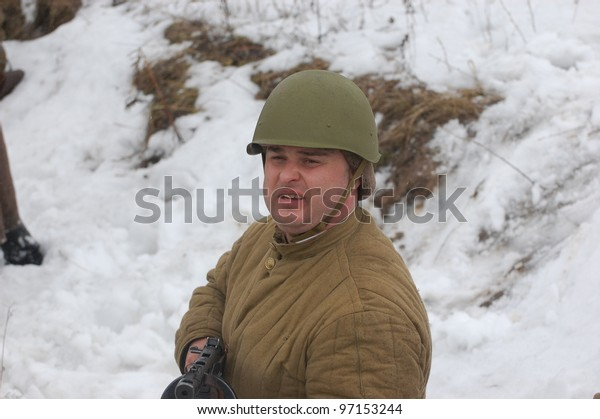 KIEV, UKRAINE -FEB 25: Unidentified member of Red Star history club wears historical Soviet uniform during historical reenactment of WWII, February 25, 2012 in Kiev, Ukraine