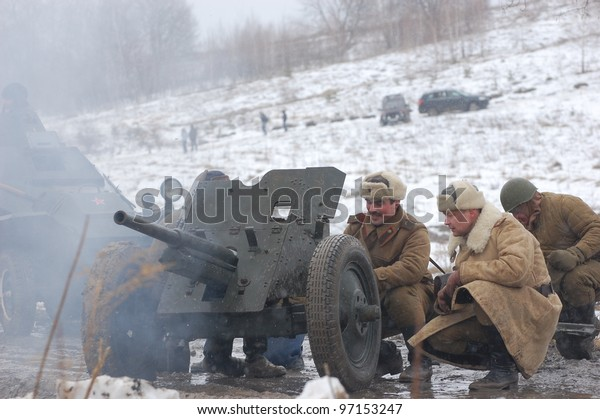 KIEV, UKRAINE -FEB 25: Unidentified members of Red Star history club wear historical Soviet uniform during historical reenactment of WWII, February 25, 2012 in Kiev, Ukraine