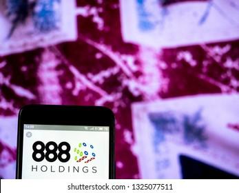 KIEV, UKRAINE - Feb 27, 2019: 888 Holdings PLC logo seen displayed on smart phone