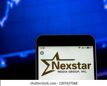 KIEV, UKRAINE - Feb 8, 2019:  Nexstar Media Group Television broadcasting company  logo seen displayed on smart phone