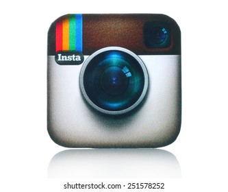 KIEV, UKRAINE - FEBRUARY 05, 2015:Instagram logotype camera printed on paper and placed on white background. Instagram is an online mobile photo-sharing, video-sharing service.