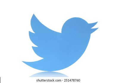 KIEV, UKRAINE - FEBRUARY 05, 2015:Twitter logotype bird printed on paper. Twitter is an online social networking service that enables users to send and read short messages.
