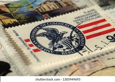 Kiev, Ukraine, February 06, 2019: Postage stamp of Germany. Shows 75 years American Chamber of Commerce in Germany, Shallow depth of field, circa 1978