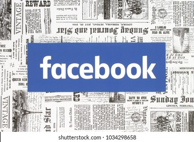 Kiev, Ukraine - February 08, 2018: Facebook logo printed on paper and placed on retro newspaper background