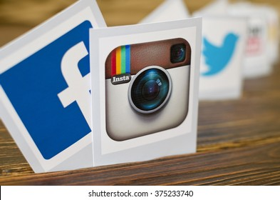 Kiev, Ukraine - February 09, 2015: Set of most popular social media icons: Facebook, Instagram,Twitter,Youtube  printed on paper on the wooden table