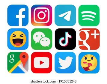 Kiev, Ukraine - February 09, 2021:   Social media logos: Facebook, Instagram, TikTok, Spotify, Telegram, WeChat, Google Plus, Google Maps,YouTube,Twitter, Empathetic Emoji reactions, printed on paper.