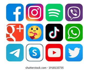 Kiev, Ukraine - February 09, 2021:  Facebook, Instagram, TikTok, Spotify, Telegram, WhatsApp, Google Plus, Viber, Skype, YouTube, Twitter, Empathetic Emoji reactions printed on paper.
