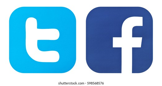 Kiev, Ukraine - February  10, 2016: Set of most popular social media icons: Twitter  and  Facebook logos printed on white paper.