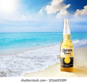 Kiev, Ukraine - February 10, 2017: Corona bottle at the beach with lime fruit ready to drink. Corona Extra is produced in Mexico and exported to all other countries all over the world.