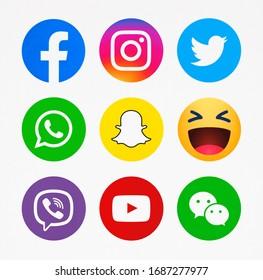 Kiev, Ukraine - February 10, 2020: New Facebook, Emoji reactions,Instagram, Twitter, Snapchat, WhatsApp, Viber, YouTube, WeChat printed on paper.