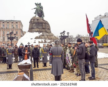 "KIEV, UKRAINE - February 12, 2015: Ukrainians attend the funeral ceremony for servicemen of ""Holy Mary"" battalion Cyril Heinz pseudo ""German"".Cyril Heinz was a citizen of the Russian Federation"
