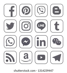 KIEV, UKRAINE - February 13, 2019: This is a photo collection of popular social media logos printed on paper: Facebook, Twitter, LinkedIn, Instagram, Tango, WhatsApp, Youtube, Line and other