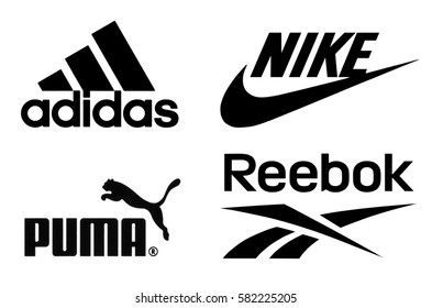 Kiev, Ukraine - February 15, 2017: Adidas, Nike, Puma and Reebok logos printed on paper and placed on white background.