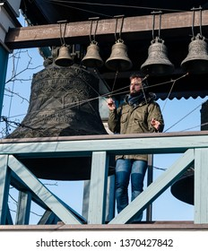 Kiev / Ukraine - February 16, 2019: The ringer men on belfry perfoming chime near Holy Trinity and St. Jonah's Monastery