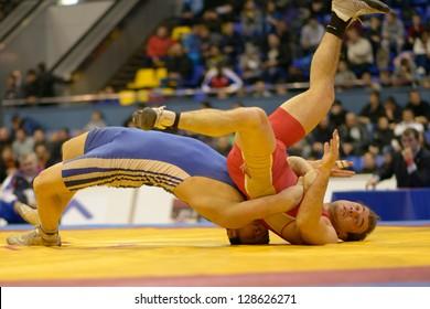 KIEV, UKRAINE - FEBRUARY 16: Match between Oganesyan, Russia, red and Magzumov, Kazakhstan during XIX International freestyle wrestling tournament in Kiev, Ukraine on February 16, 2013