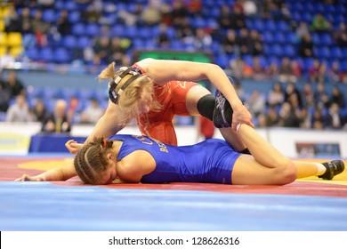 KIEV, UKRAINE - FEBRUARY 16: Match between Lampe, USA, red and Bezruka, Ukraine during XIX International freestyle wrestling and female wrestling tournament in Kiev, Ukraine on February 16, 2013