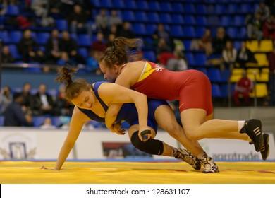 KIEV, UKRAINE - FEBRUARY 16: Match between Synyshyn, Ukraine, red and Husiak, Ukraine during XIX International freestyle wrestling and female wrestling tournament in Kiev, Ukraine on February 16, 2013