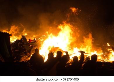 KIEV, UKRAINE February 18, 2014: Protesters set fire to barricades in Kyiv. The revolution in Ukraine