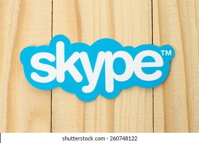 KIEV, UKRAINE - FEBRUARY 19, 2015: Skype logotype printed on paper and placed on wood background. Skype is a telecommunications application software developed by Microsoft.