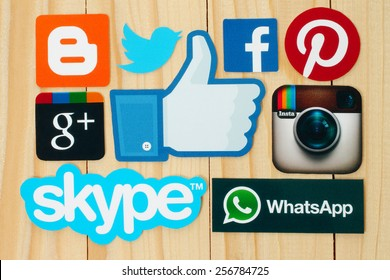 KIEV, UKRAINE - FEBRUARY 19, 2015:Collection of popular social media logos printed on paper:Facebook, Twitter, Google Plus, Instagram, Skype, WhatsApp, Pinterest and Blogger on wooden background