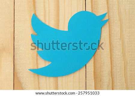 KIEV, UKRAINE - FEBRUARY 19, 2015:Twitter logotype bird printed on paper. Twitter is an online social networking service that enables users to send and read short messages.