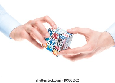 KIEV, UKRAINE - FEBRUARY 2, 2013: Male hands holding Rubik's cube with logotypes of well-known social media brands. Include Facebook, YouTube, Twitter, Google Plus, Instagram, Flickr and other logo.