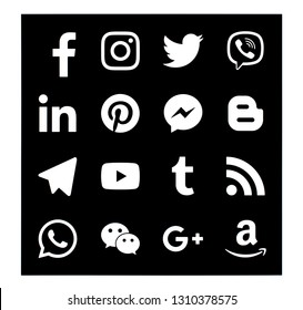 KIEV, UKRAINE -   February 2, 2019: This is a photo collection of popular social media logos printed on paper: Facebook, Twitter, LinkedIn, Pinterest, Instagram, Youtube, Line and other