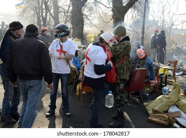KIEV, UKRAINE - February 21, 2014: Ukrainian revolution, Euromaidan. Medical volunteers help barricade defenders