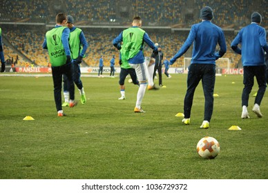 """KIEV, UKRAINE - FEBRUARY 22, 2018: UEFA Europa League match between FC DYNAMO KIEV and FC AEK ATHENS at the NSC """"Olympic"""": official ball of the tournament is the League of Europe. Warm up players"""