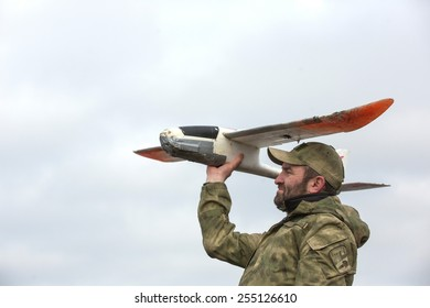 KIEV, UKRAINE - FEBRUARY, 23, 2015: Volunteers provide training for military personnel and other volunteers to control unmanned aerial vehicles for further use in the area of anti-terrorist operation