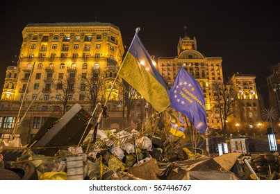 Kiev, Ukraine - February 26, 2014:  Barricades with tires and flags in Kiev on Maidan Square during the revolution in the Ukraine.