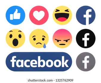 Kiev, Ukraine -  February 26, 2019: New Facebook logo with like button and Empathetic Emoji Reactions printed on white paper.