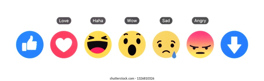 Kiev, Ukraine - February 26, 2019: New Facebook like button 7 Empathetic Emoji Reactions printed on white paper. Facebook tests new Downvote button