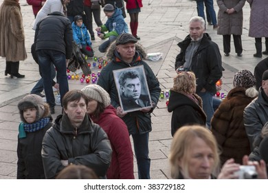 KIEV, UKRAINE- FEBRUARY 27, 2016. Anniversary of murder of the oppositional politician Boris Nemtsov. People bring flowers to honor memory of the politician. The meeting at the Maidan Nezalezhnosti